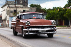 American classic car drived on the road in havana Royalty Free Stock Image
