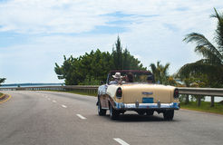 American classic car drived on the roadnin havana Royalty Free Stock Photo