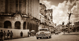American classic car drives on the main street with street life view in Havana Cuba - Retro Ser. Ie SEPIA Cuba Reportage Royalty Free Stock Photography