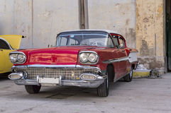 American classic car in Havana, Cuba. Front view of a red american classic car stock image