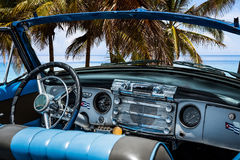 American classic car with interior view on the beach in Varadero - Serie Kuba 2016 Reportage Royalty Free Stock Photos