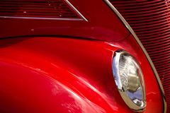 American Classic Car Show. Headlight grill and quarter panel of red vintage car at classic car show Royalty Free Stock Photography