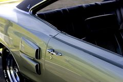 American Classic Car Show. Rear passenger side of classic muscle car at a car show royalty free stock images