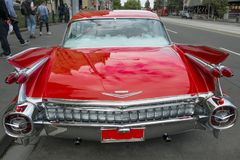 American classic car - tail of red Cadillac. Red tail with furbished chrome of well maintained red Cadillac royalty free stock photo