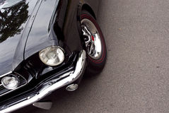 American Classic - Closeup Black Front. Closeup of the headlight and front of a black american classic from the 60s Royalty Free Stock Images