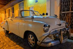 American classic convertible in the cobble street of Trinidad, Cuba Royalty Free Stock Photo