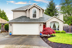 American classic home with beige exterior paint. Royalty Free Stock Image
