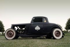 American Classic - Rat Rod. A black american 1930s rat rod car parked in a field Stock Images