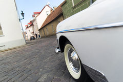 American classic white oldtimer riding in the old town streets of Tallinn Royalty Free Stock Images