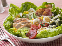 American Cobb Salad. On table with fork stock image