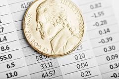 American coin on fluctuating graph. Royalty Free Stock Images
