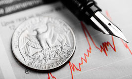 American coin on fluctuating graph. Rate of the dollar. (shallow DOF Royalty Free Stock Photos
