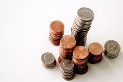 American coins. Stacks of pennies, nickels and dimes, white background royalty free stock image
