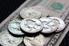 American coins on dollar note,selective focus .coins for saving. Pay ,change.the American money in world business royalty free stock image