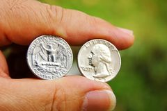 American coins in hand . American coins in hand with blur background.business or saving concept stock photography