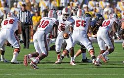 American college football - handoff. MORGANTOWN, WV - NOVEMBER 5: Louisville quarterback Teddy Bridgewater (#5) prepares to hand the ball off to a running back stock photos