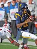 American college football - quarterback scramble Stock Photography