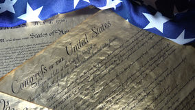 American Constitution and US Flag. United States Bill of Rights Preamble to the Constitution and American Flag Royalty Free Stock Image