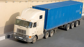 American container truck. On road part of business vehicles series Stock Photos