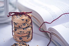 American cookies with chocolate next to the book Royalty Free Stock Image