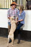 American couple dog Royalty Free Stock Photography