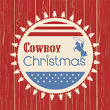 American cowboy christmas greeting card on wood board Royalty Free Stock Photography