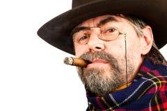American cowboy smoking cigar Royalty Free Stock Image