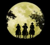 Three Cowboys Under The Moonrise Royalty Free Stock Photography