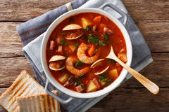 American cuisine: Manhattan clam chowder soup closeup. horizonta Stock Images