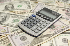 American Currency And Calculator Royalty Free Stock Photo