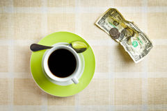 American currency and coffee cup Stock Images
