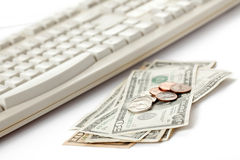 American currency and computer keyboard Royalty Free Stock Photos