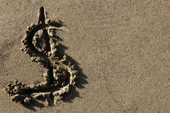 American currency dollar sign on the beach sand. American currency simbol, dollar sign written on the beach sand stock images