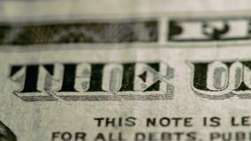American Currency. Extreme Close-up slow pan across dollar bill stock footage