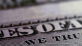 American Currency. Extreme Close-up slow pan across hundred dollar bill stock footage