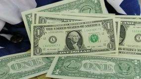American currency falling on flag stock footage