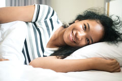 The american cute girl wake up and smile for  happy dream on whi Stock Images