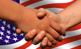 American deal. Photo of handshake with american flag at the background Royalty Free Stock Photography