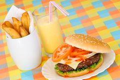 American Diner. Open burger and fries in American diner setting with milkshake Stock Images