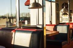 American diner interior at sundown. American diner seats. Diner interior. Big windows at sunset royalty free stock photo