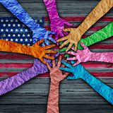 American Diversity. Holding as diverse hands made of crumpled paper connected together as a concept for citizen solidarity and patriotic friendship in the stock illustration