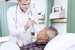 American doctor checking his patient eyes Stock Photo