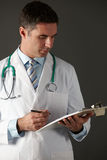 American doctor with clipboard and stethoscope Royalty Free Stock Photos