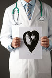 American doctor holding ink drawing of heart Royalty Free Stock Photos