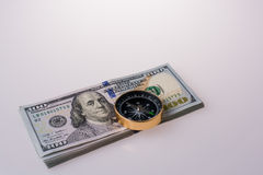 American dollar banknotes on a compass Royalty Free Stock Images