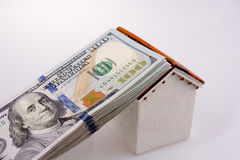 American dollar banknotes on the roof of a model house Stock Photo