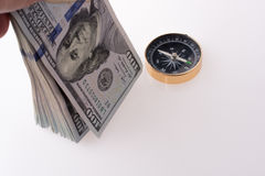 American dollar banknotes by the side of a compass Stock Photos