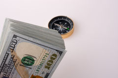 American dollar banknotes by the side of a compass Royalty Free Stock Photos