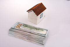 American dollar banknotes by the side of a model house Stock Photo