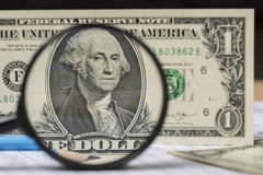 American dollar bill and pencil through a magnifying glass Stock Image